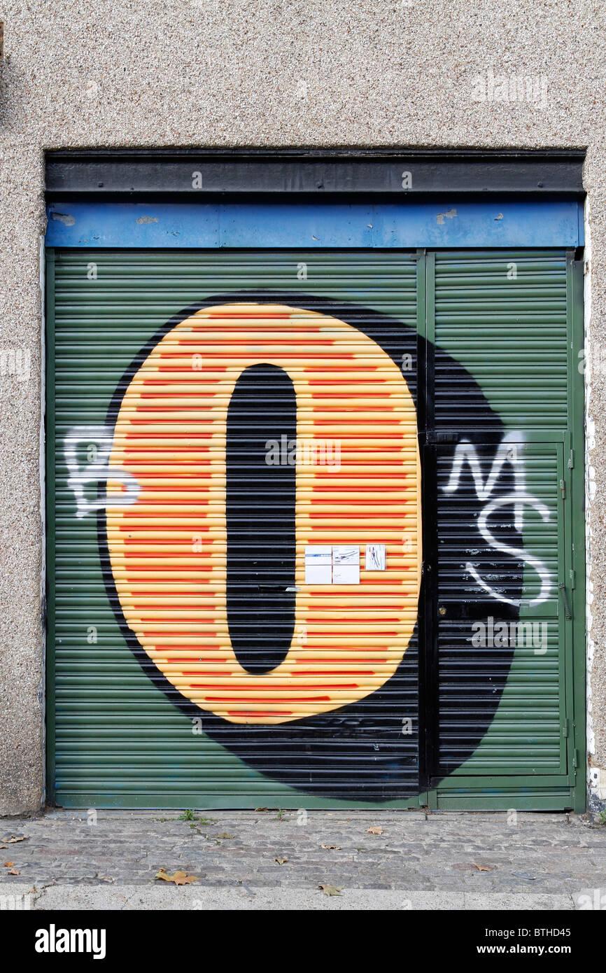 Ben eine graffiti picture letter on shutters london shoreditch stock image