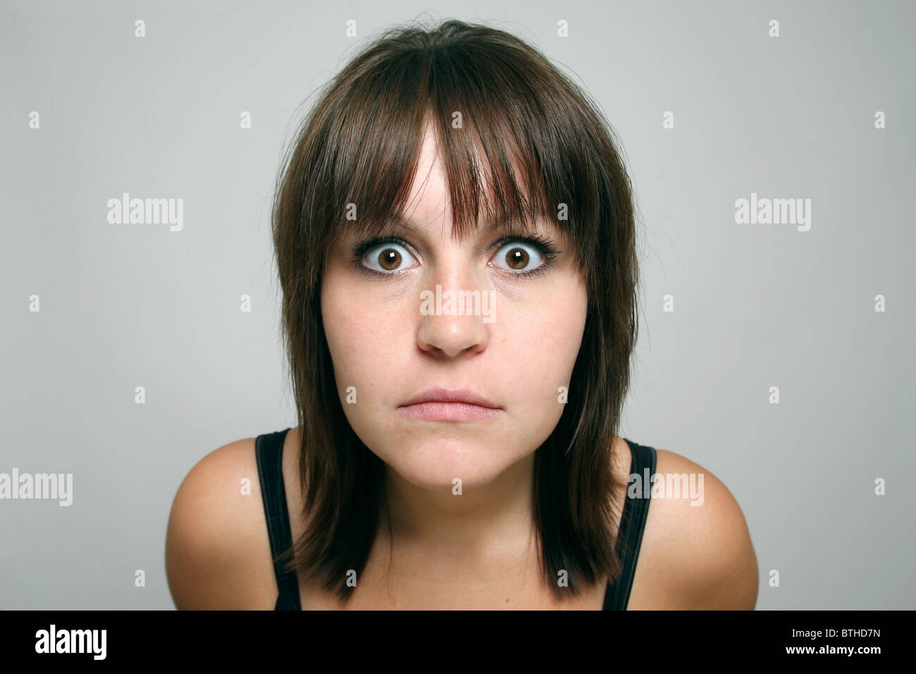 A frightened woman - Stock Image