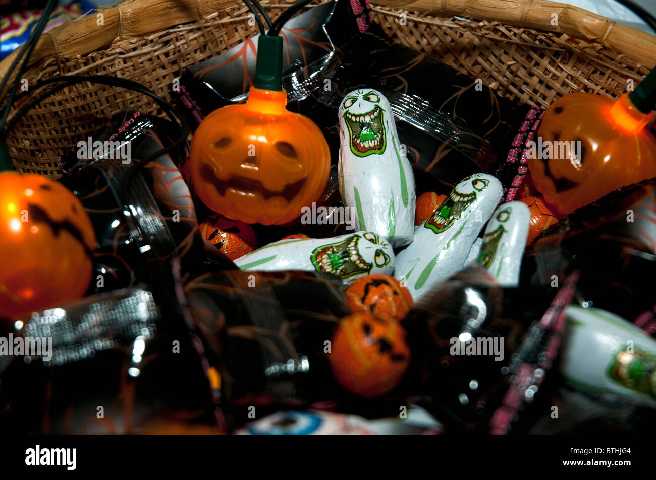 a halloween basket of sweets and offerings to children and trickle treaters on this ghoulish evening of 31st October - Stock Image
