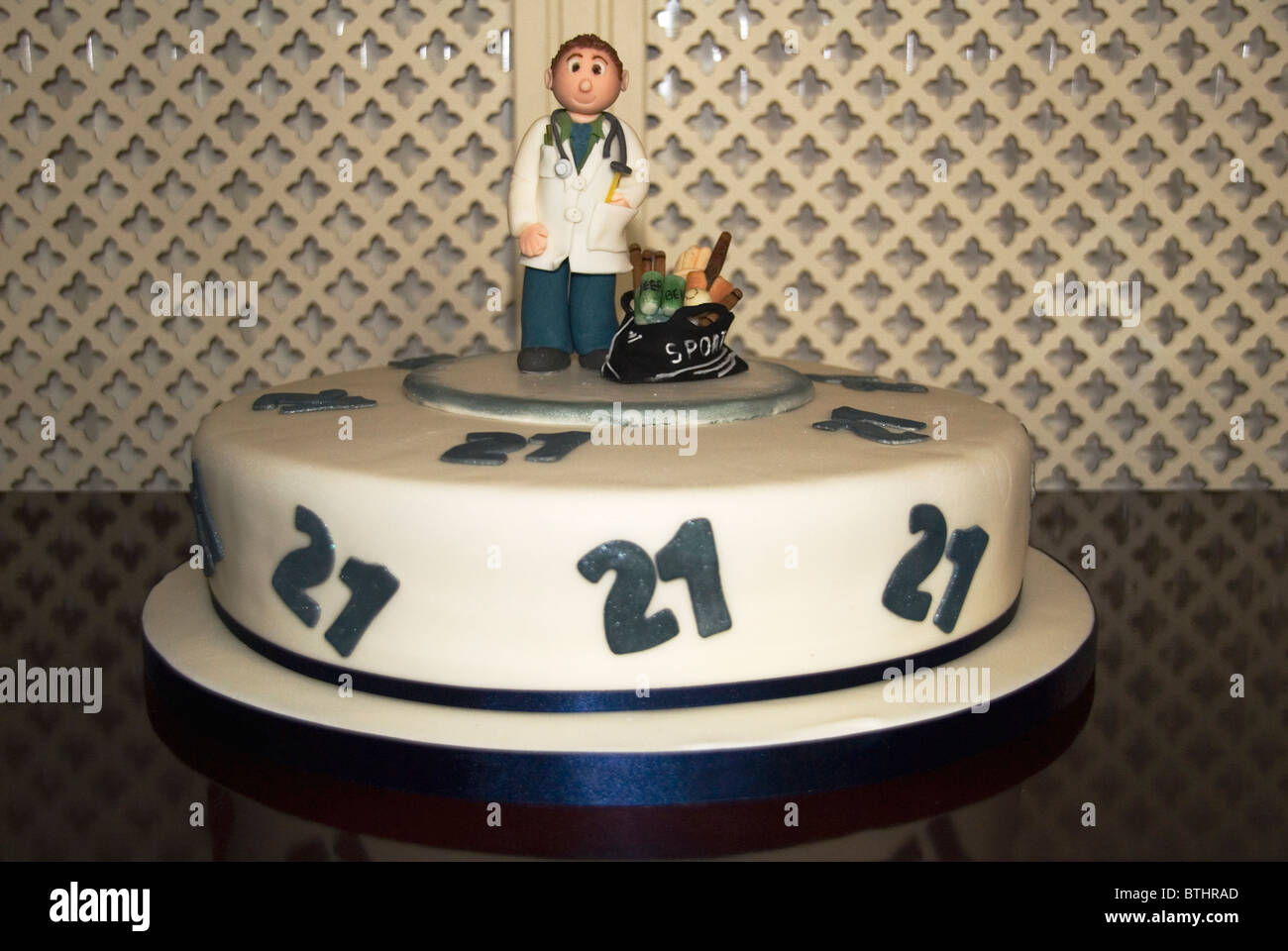 A 21st birthday cake portraing a sports enthusiastic doctor Stock