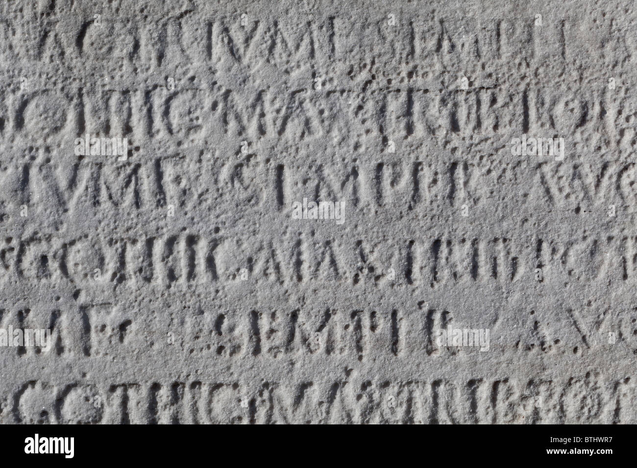 Latin inscription on stone on the ponte cestio in Rome, Italy - Stock Image