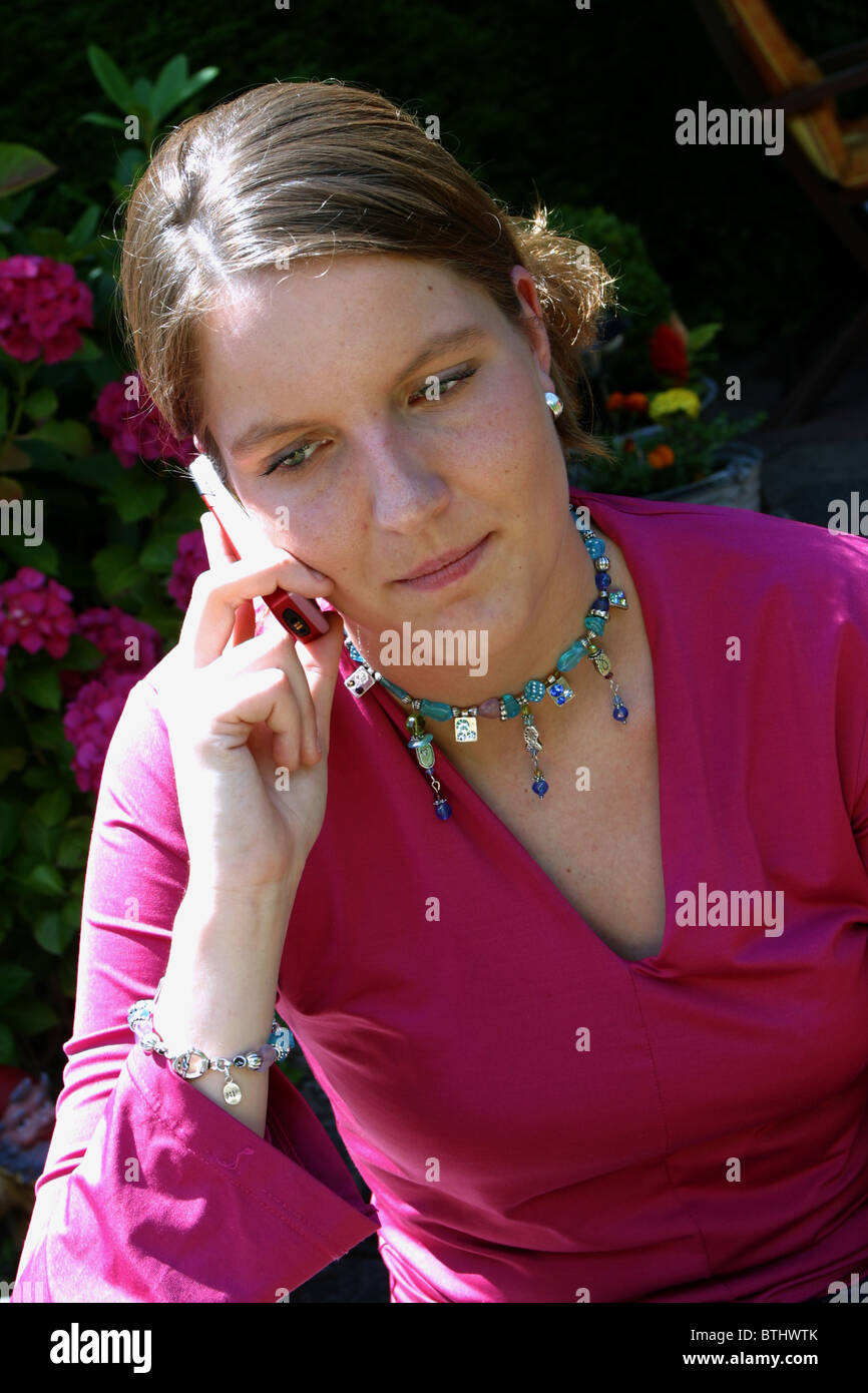 Young white woman gets bad news during phone call - Stock Image