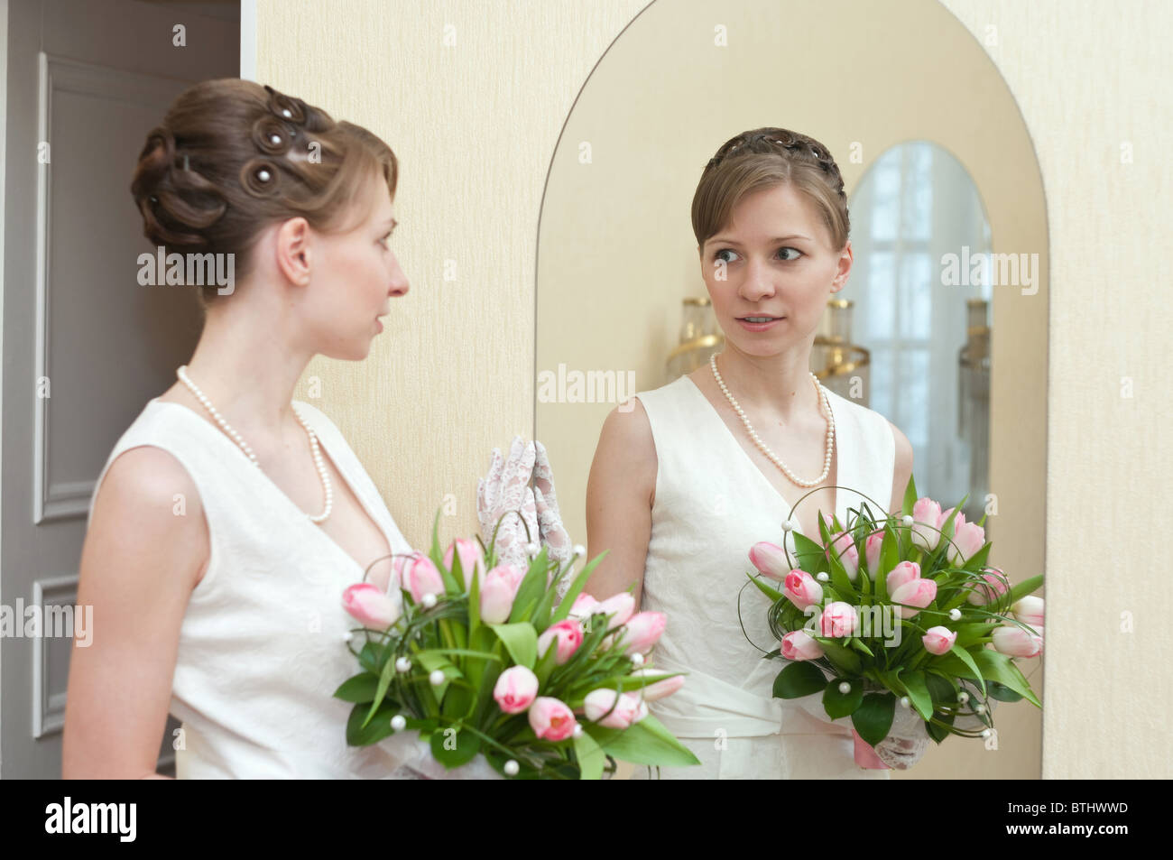 Bride Of A Beautiful Young Blonde Girl Is Standing Near The Mirror