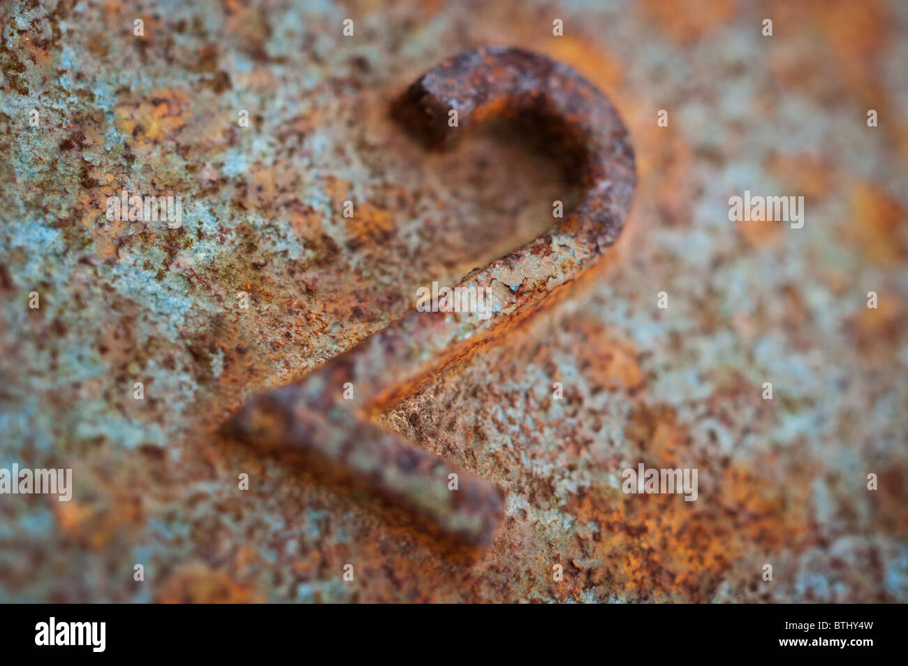 Number two 2 symbol on a rusted 2 kg gym weight. - Stock Image