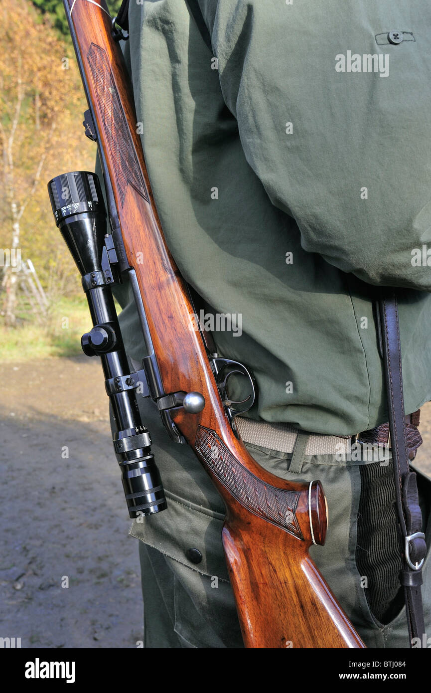 Hunter with shotgun and scope in the Ardennes, Belgium - Stock Image