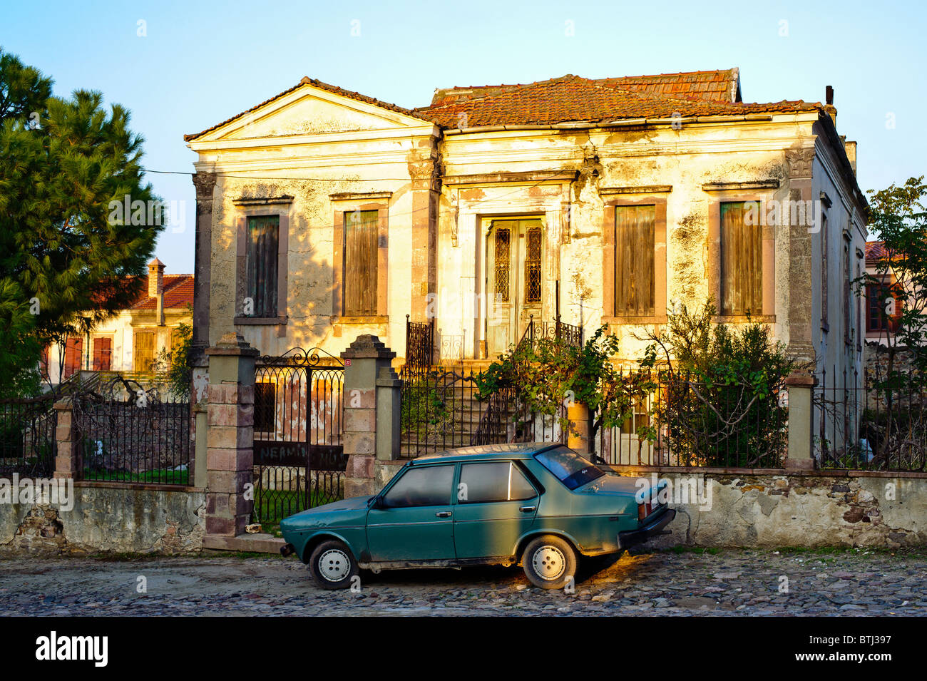 Greek house and Turkish car, Cunda Island, near Ayvalik, Turkey. - Stock Image