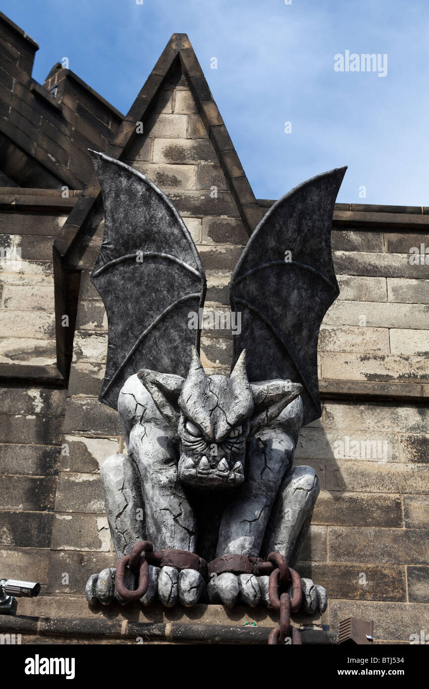stone carved chained fierce winged monster, Eastern State Penitentiary (ESP), Philadelphia, Pennsylvania, USA - Stock Image