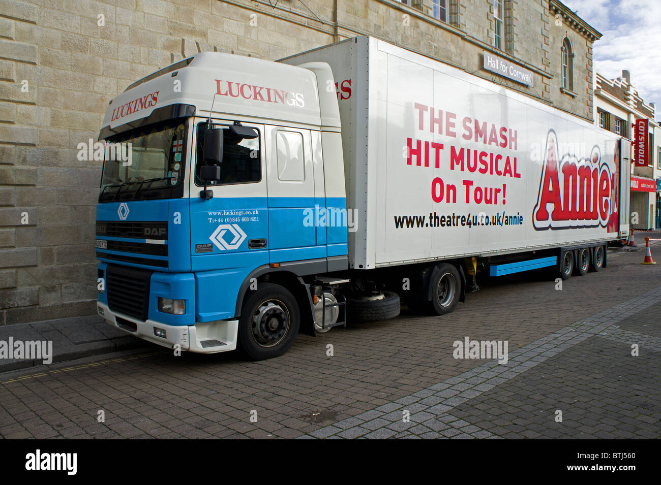 The Hit Musical ' Annie ' stage equipment delivery wagon outside a theatre in Truro, Cornwall, UK - Stock Image