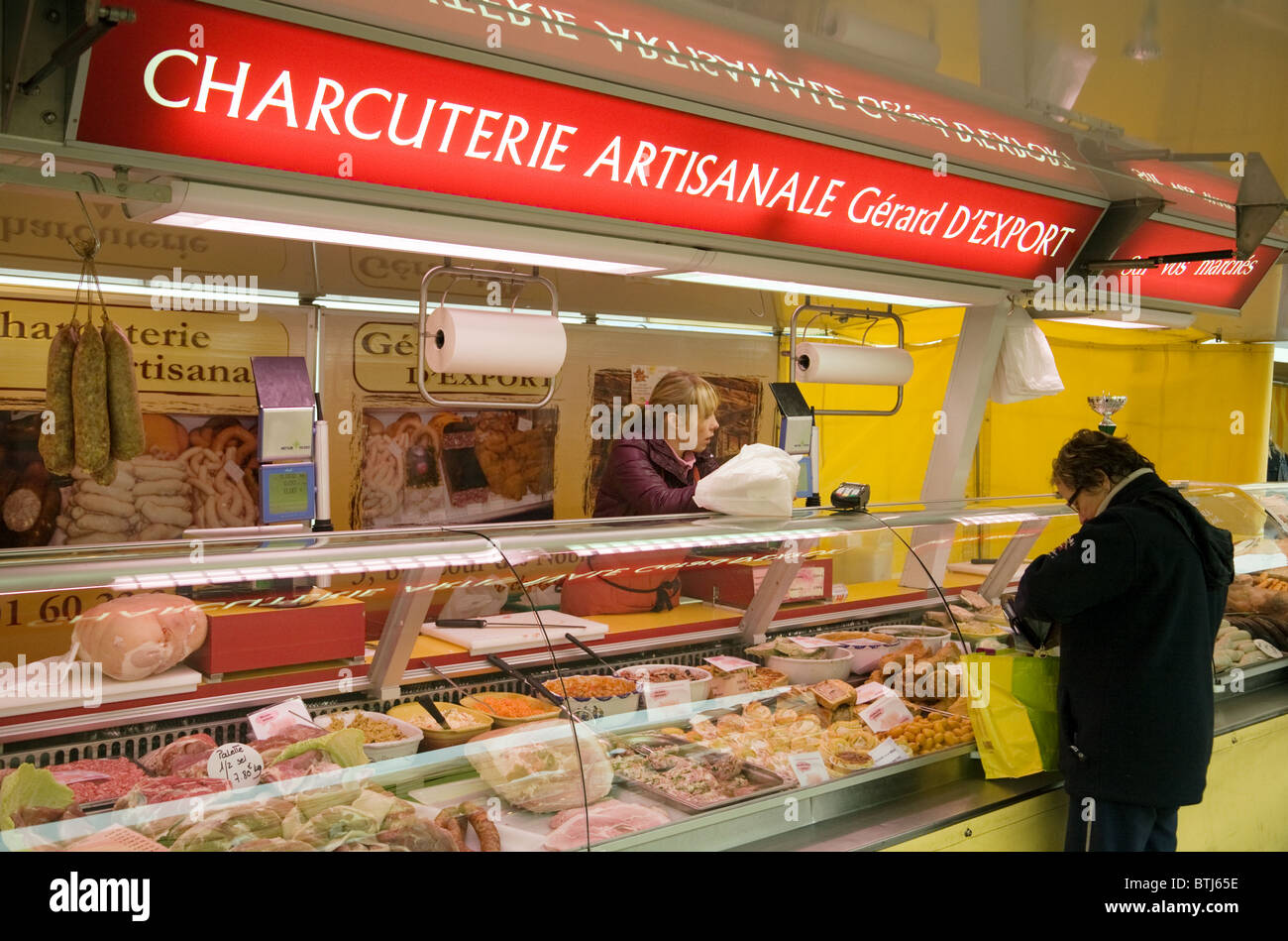 A person shopping for meat at the Charcuterie (Butchers) stall, Coulommiers town street market near Paris  ile de - Stock Image