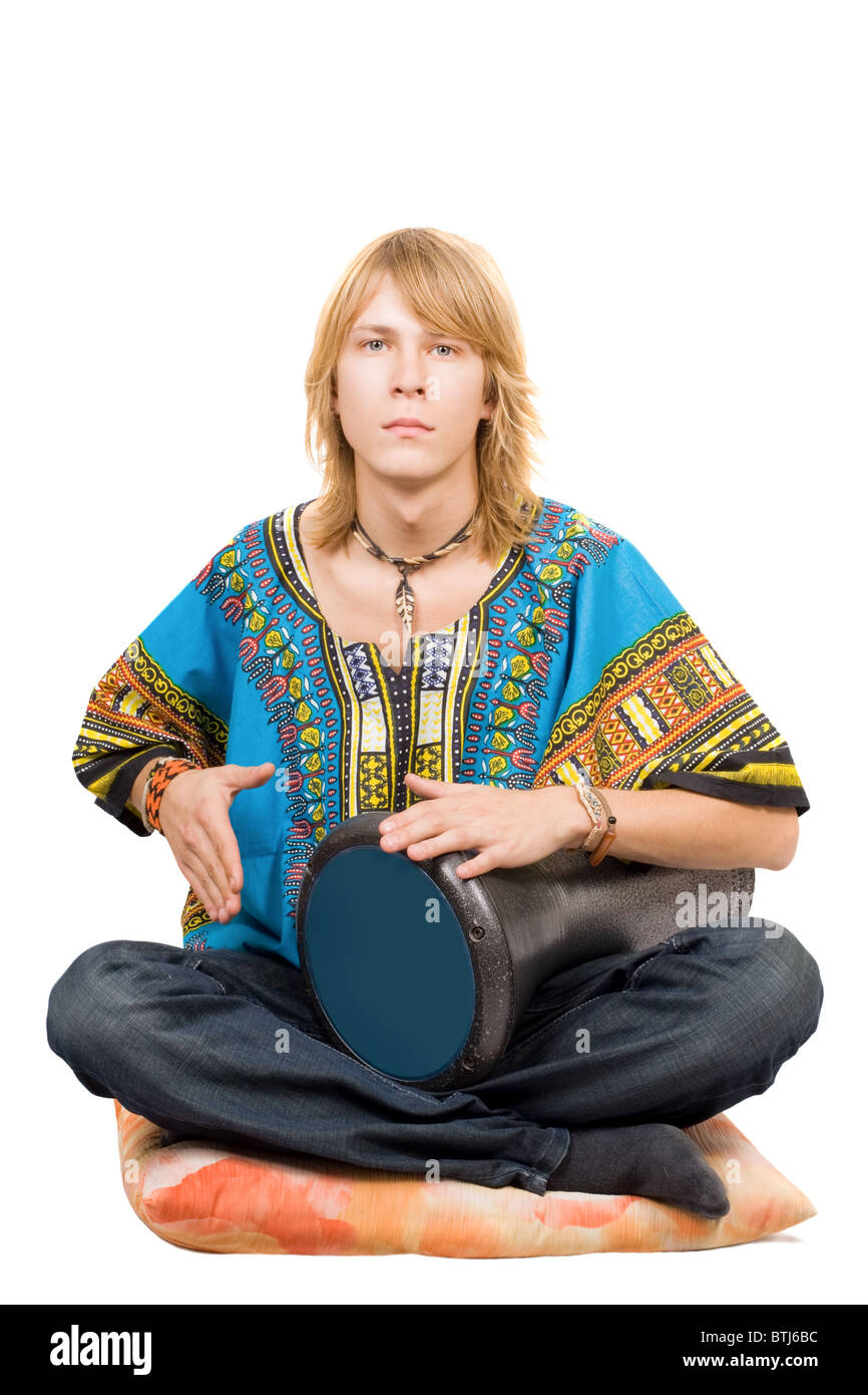 The young man plays a drum. Isolated - Stock Image