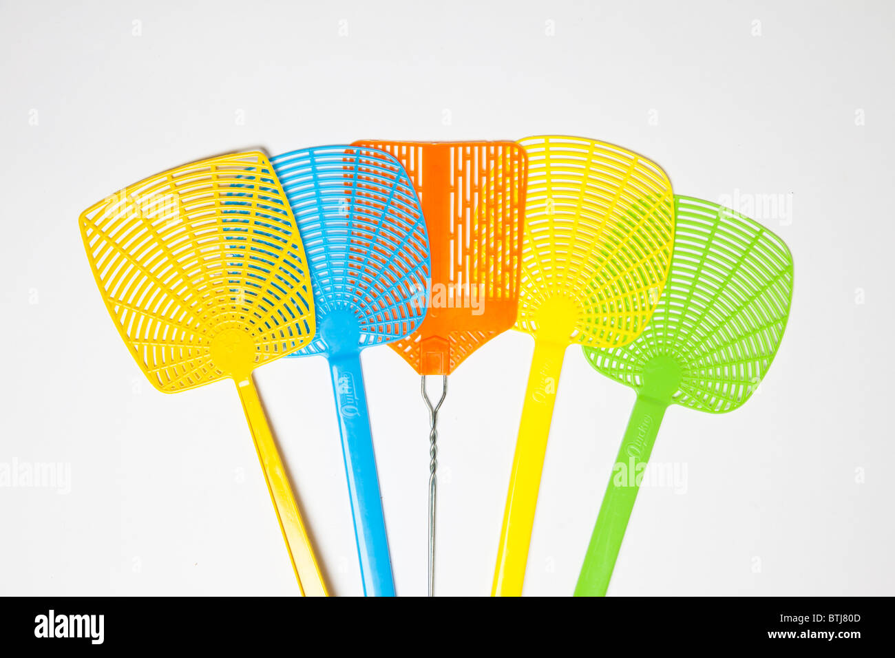 colorful plastic fly swatters - Stock Image