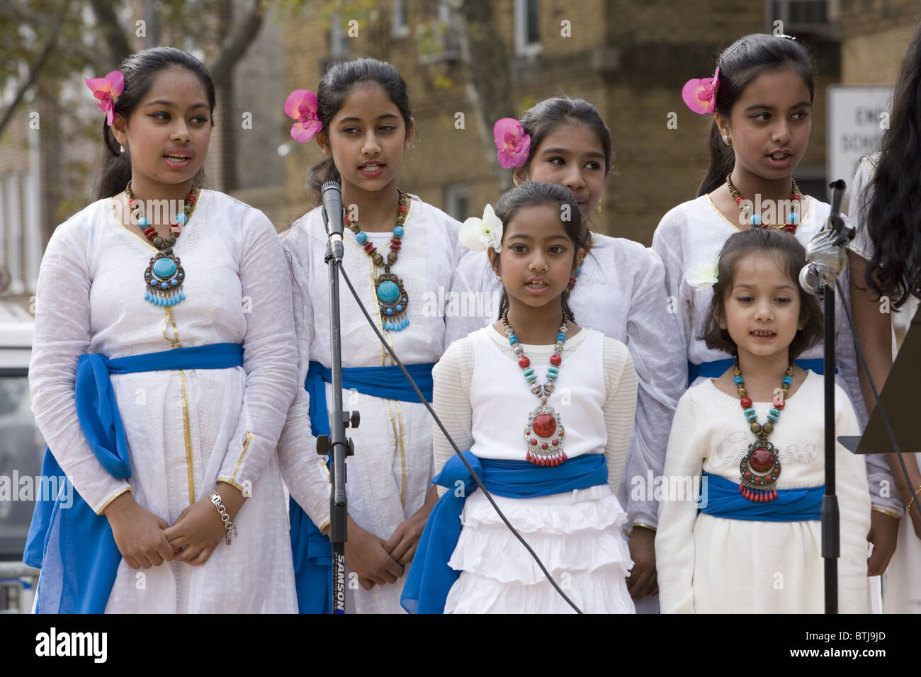 Bangladeshi American childrens chorus perform at a festival for world cultures in Brooklyn, New York. - Stock Image