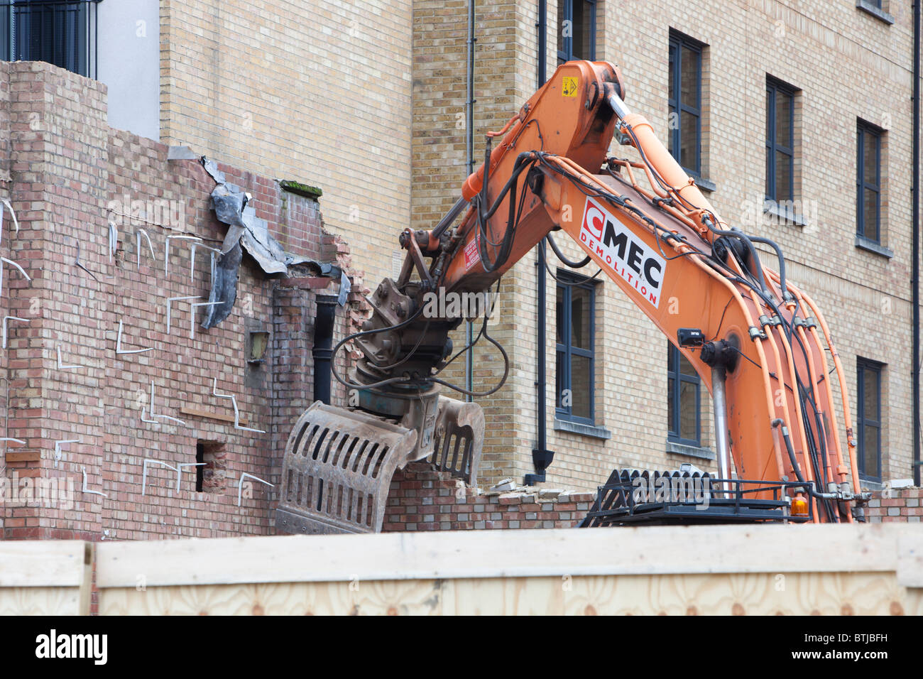 A building being demolished near the Angel tube in london, UK. - Stock Image