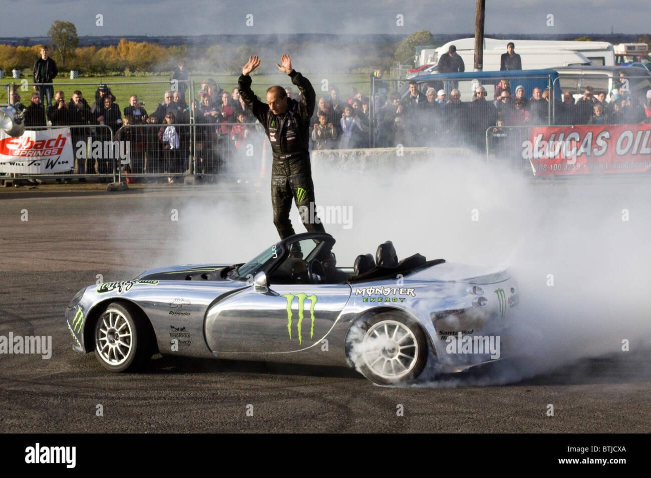 A Stunt man entertaining the crowd at Santa Pod Raceway England - Stock Image