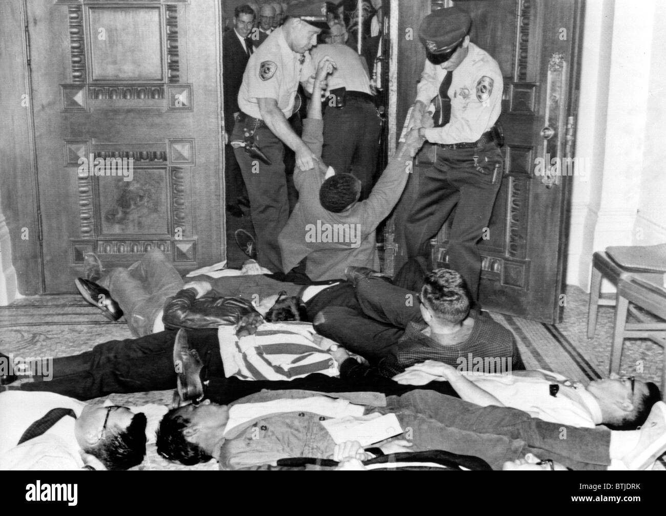 Demonstators removed by police in Sacramento,CA 6/14/63.  CORE sponsored lie-in for fair housing bill. - Stock Image