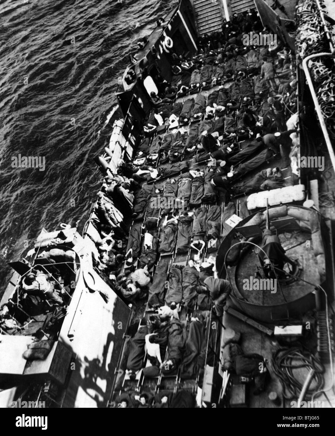 Wounded U.S. and British soldiers being taken away from the capture of Cherbourg, June 28, 1944. CSU Archives/Courtesy - Stock Image
