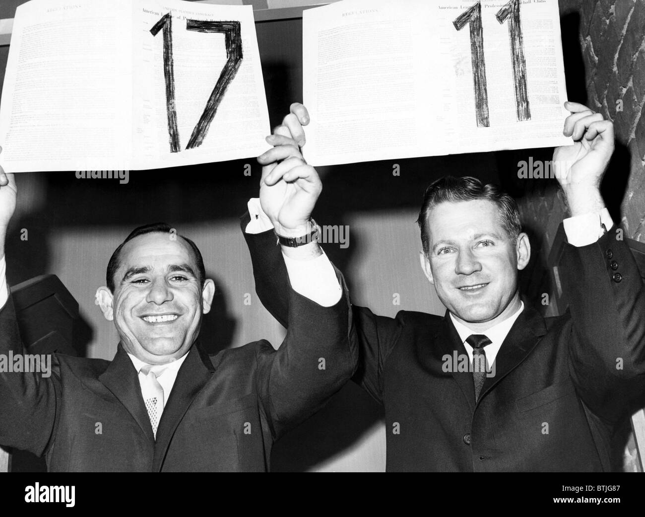 Yogi Berra and Whitey Ford hold up their 17th and 11th contracts with the Yankees, respectively, 1962. Courtesy: - Stock Image