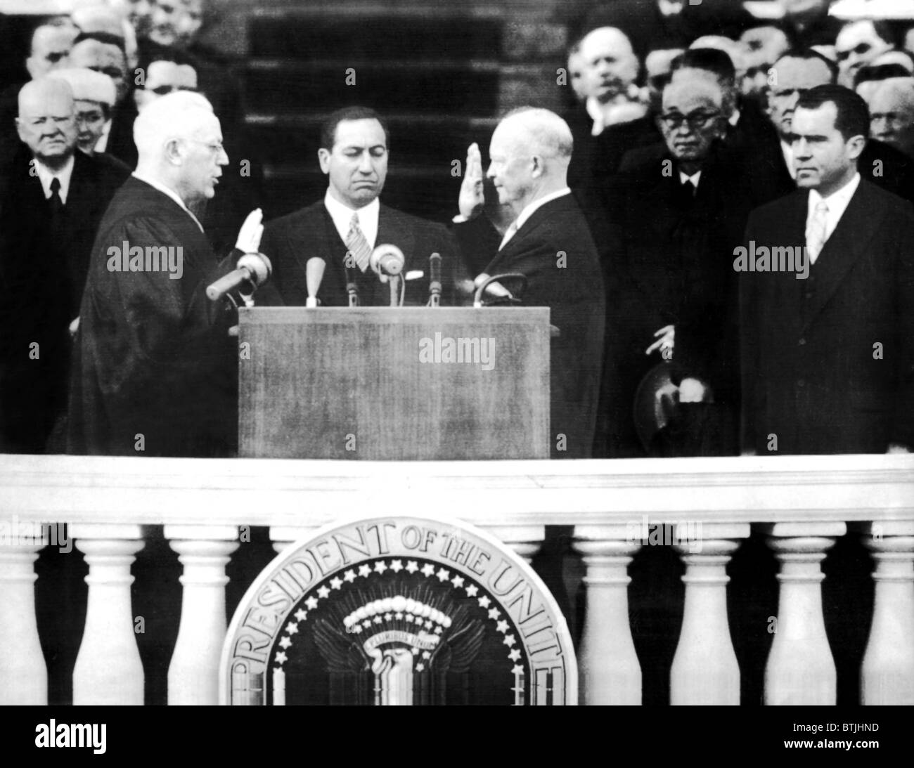 President Dwight D. Eisenhower (3rd from left), being sworn in for his 2nd term; Chief Justice Earl Warren (left), - Stock Image