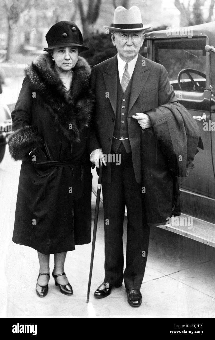 Mr. and Mrs. Edward L. Doheny, oil magnate and businessman, leaving a Washington courtroom, after facing bribery - Stock Image