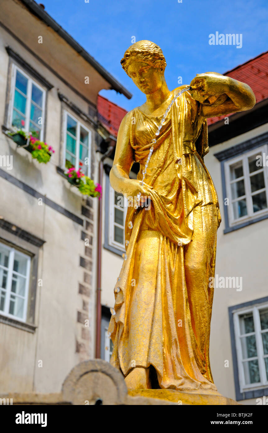 Ljubljana, Slovenia. Gold painted fountain in Ribji trg (Fisherman's Square) - Stock Image