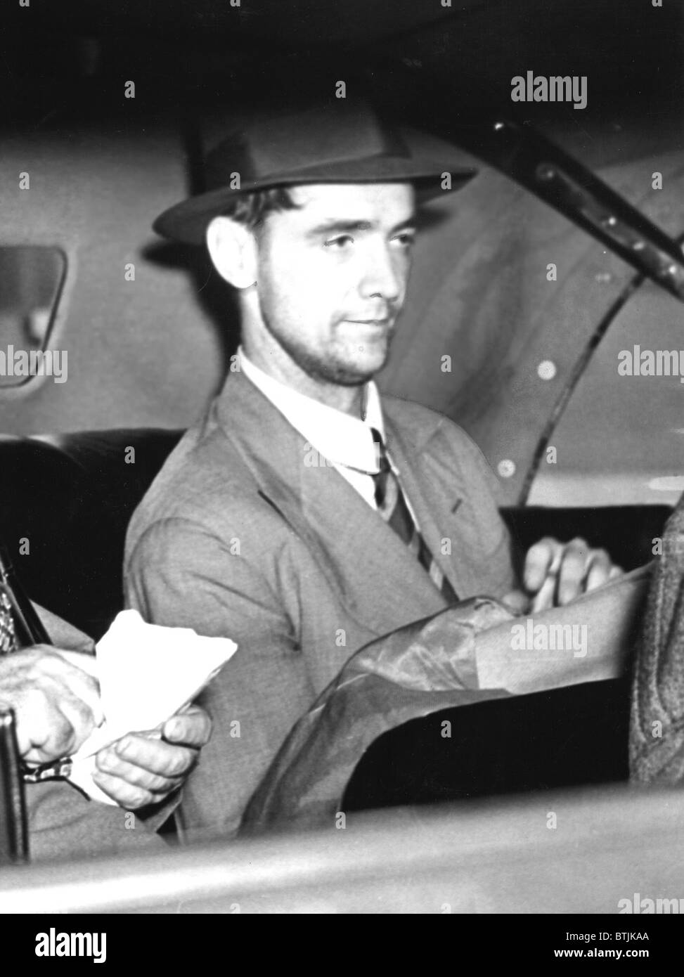 Howard Hughes leaves Floyd Bennett Field, NYC after his round the world flight of 3 days, 19 hours, 17 mins. 7/14/38 - Stock Image