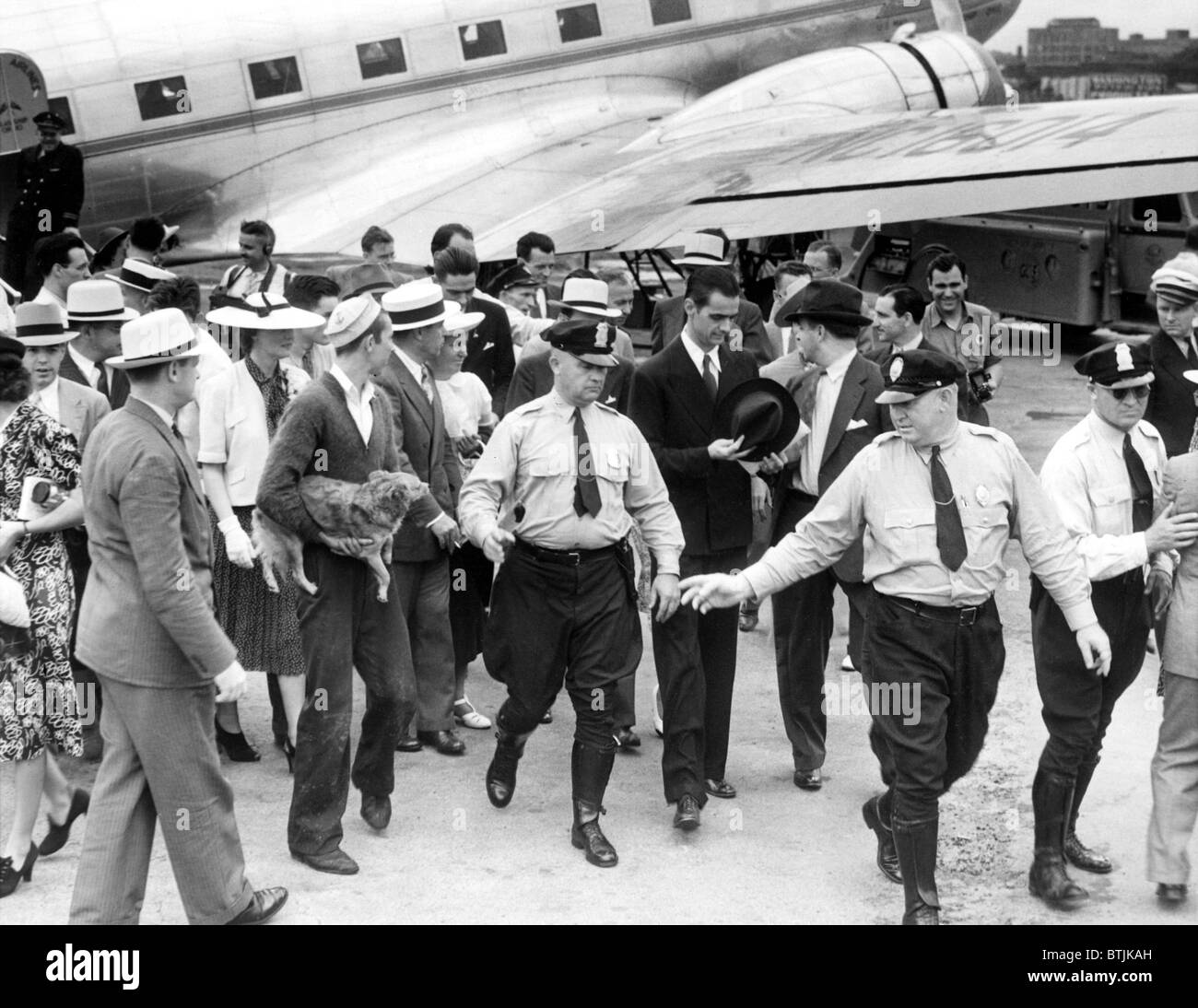 Howard Hughes leaves his plane in Washington, DC after his round the world flight, 7/21/38 - Stock Image