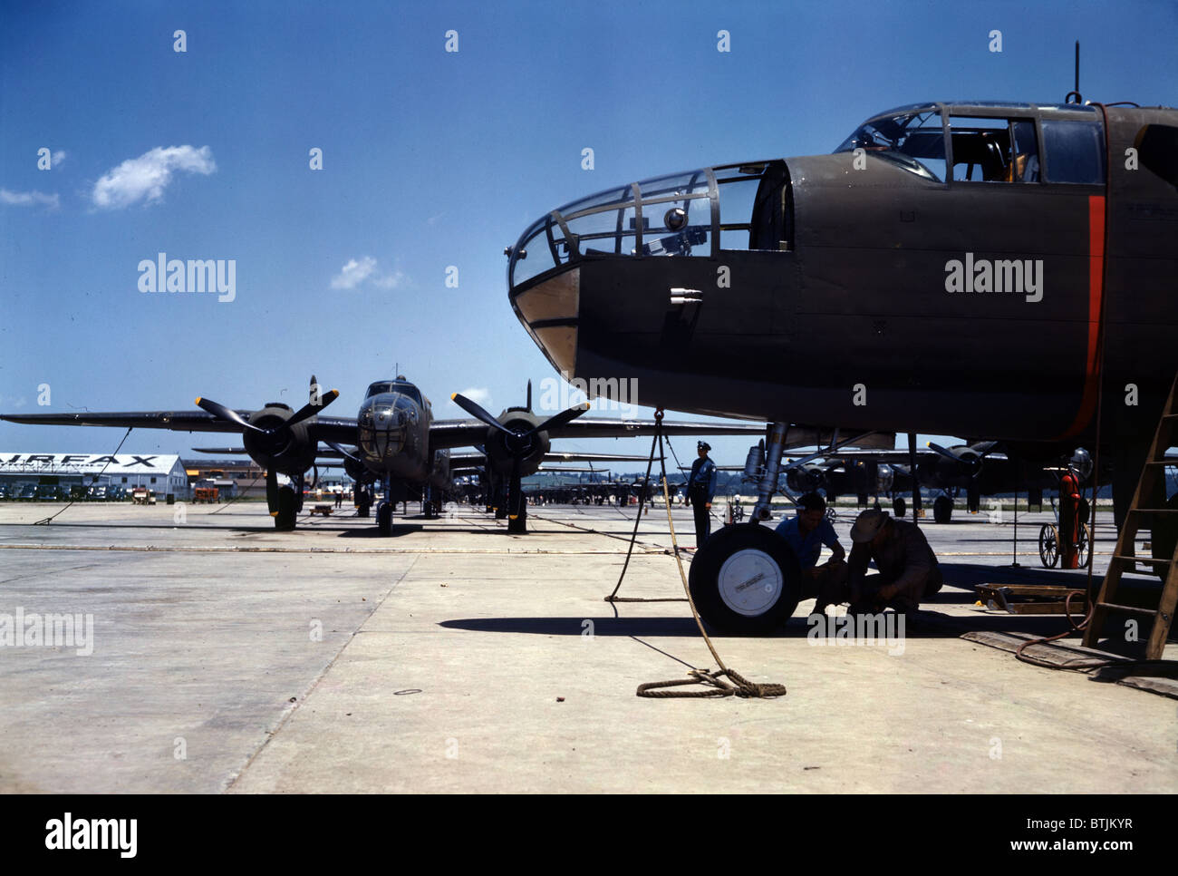 New B-25 bombers lined up for final inspection and tests at the flying field of an aircraft plant, North American - Stock Image