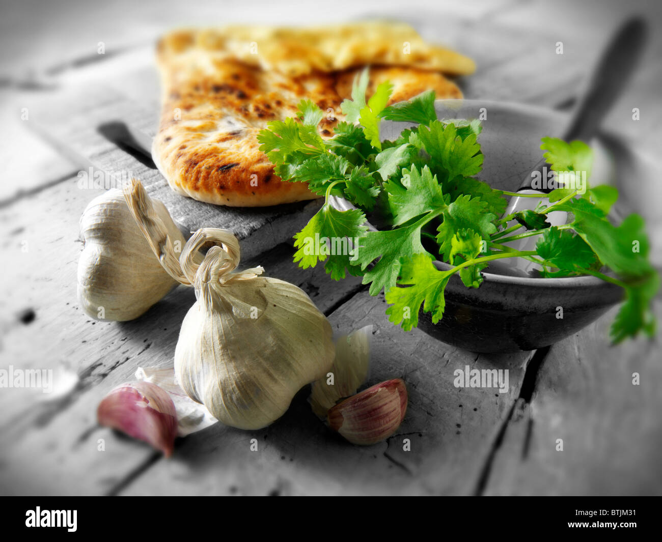 Corriander and Garlic Indian Naan bread - Stock Image