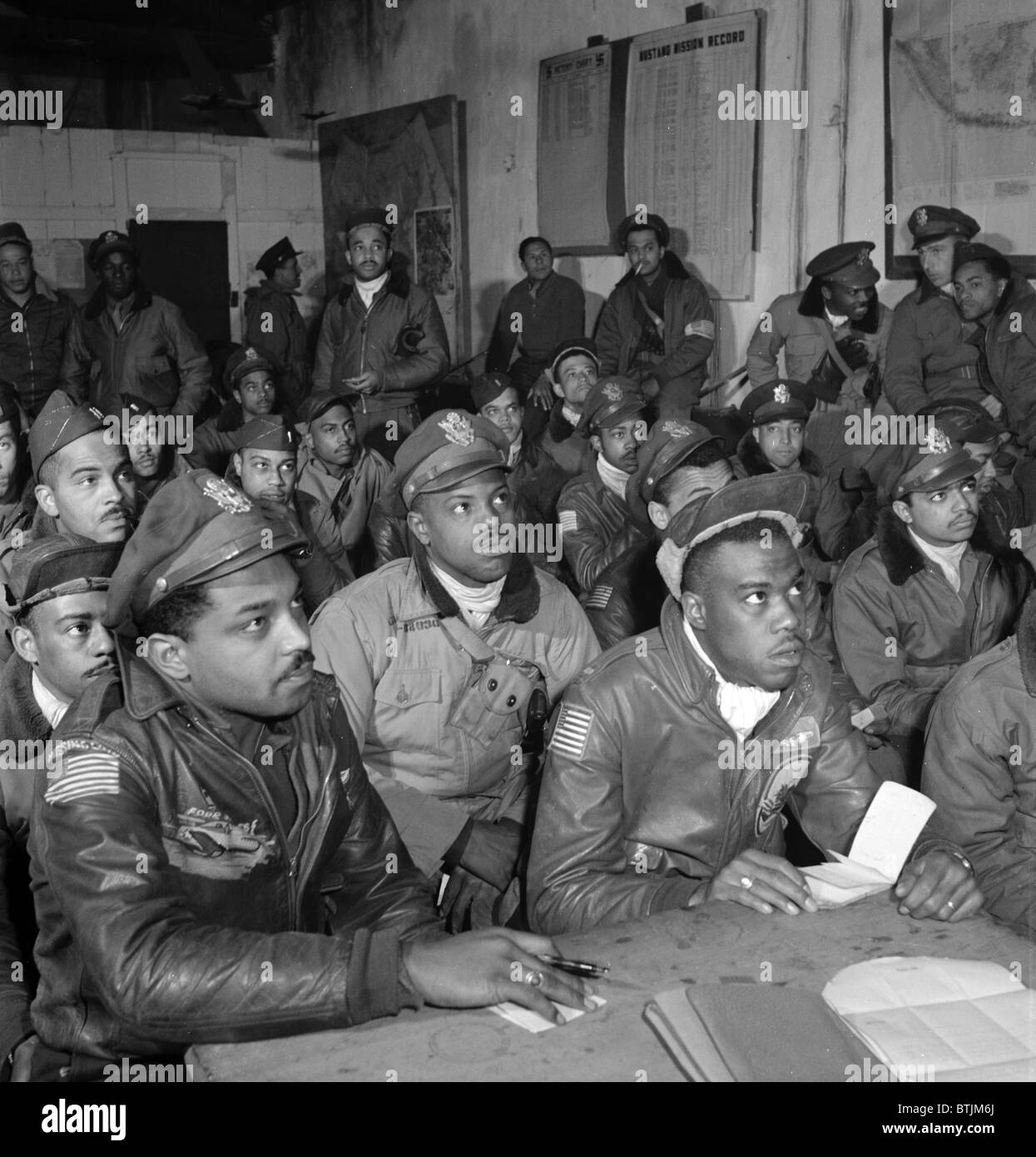 Tuskegee airmen attend a briefing in Ramitelli, Italy, March 1945. Photograph by Toni Frissell. - Stock Image