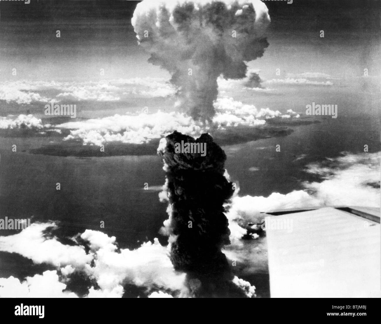 Atomic bomb. A mushroom cloud rises more than 60,000 feet into the air over Nagasaki, Japan after an atomic bomb Stock Photo