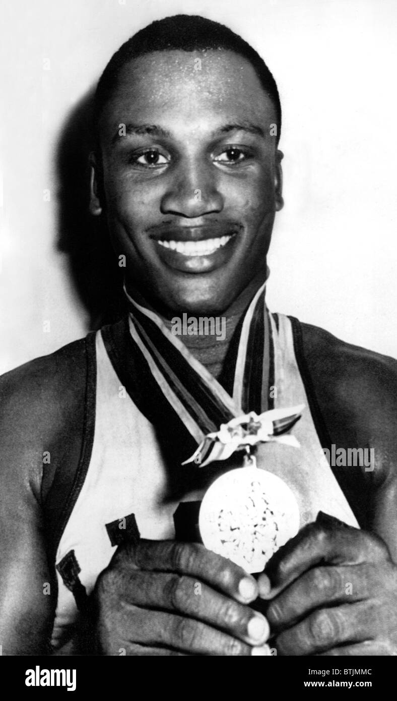 Joe Frazier holding Olympic heavyweight gold medal, Tokyo, 10/23/1964 - Stock Image