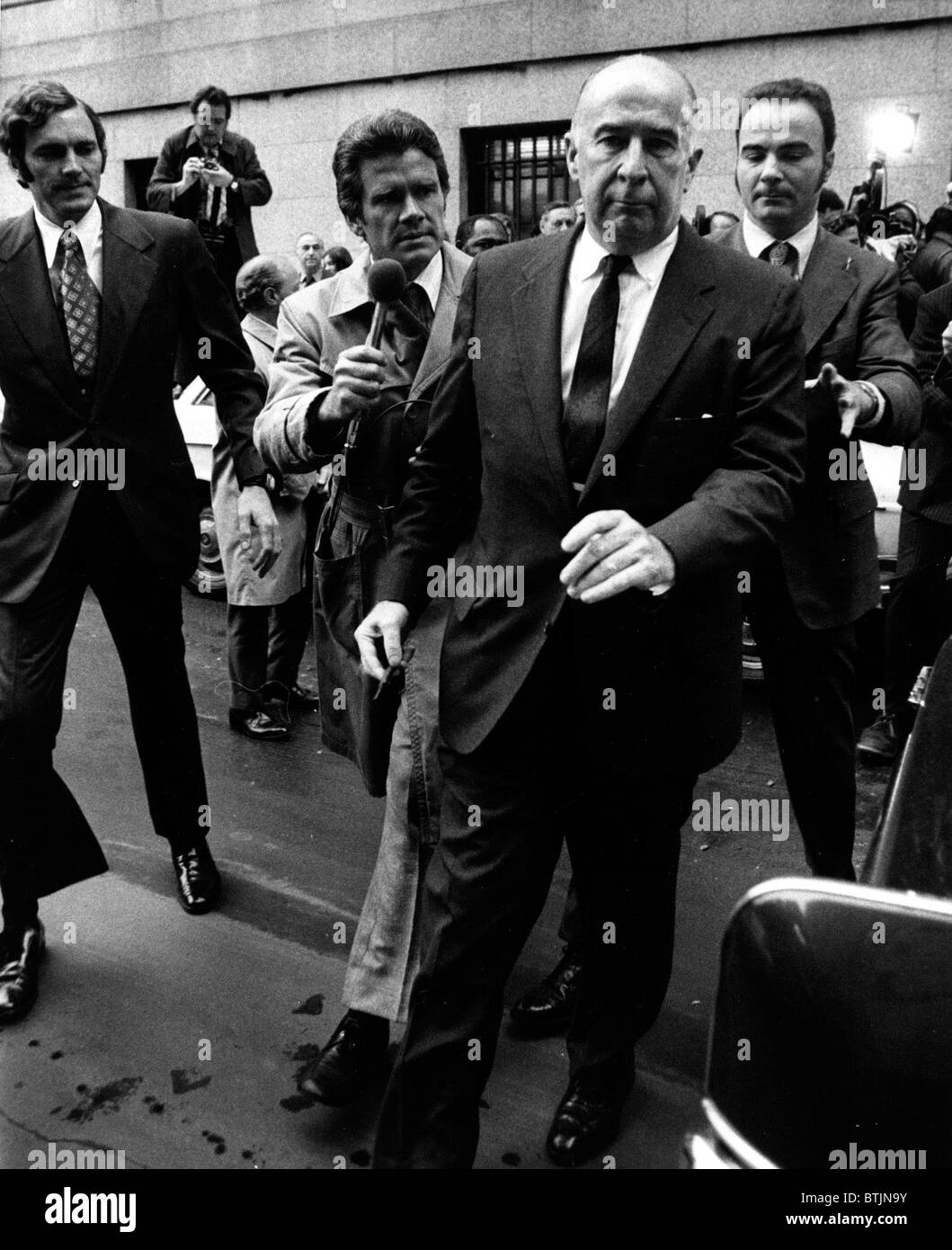 Former Attorney General John Mitchell leaving Federal Court where he pleaded not guilty to charges of perjury and - Stock Image