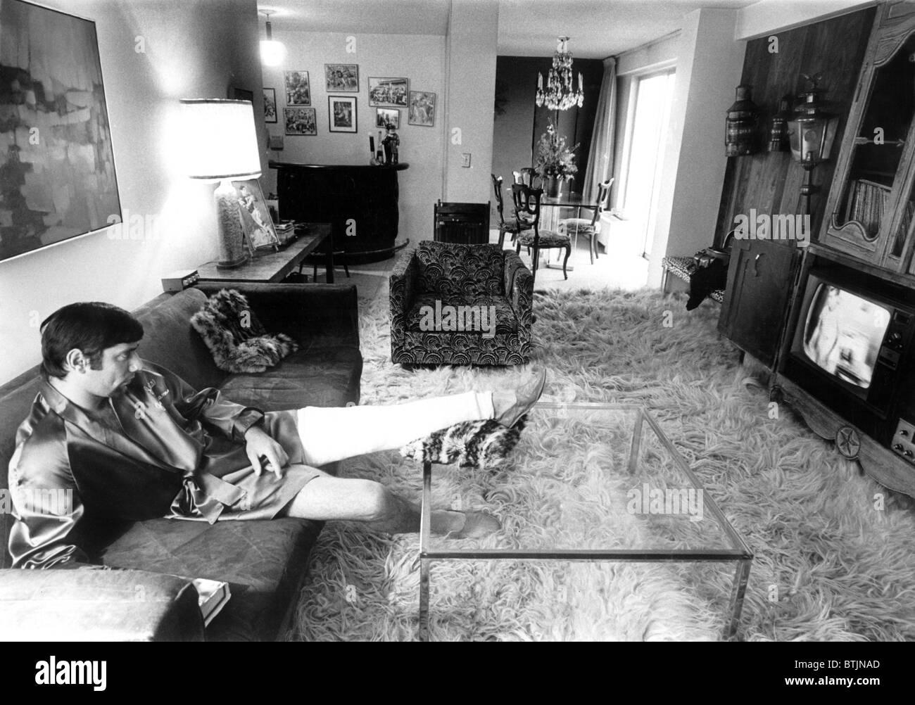 Joe Namath, in full-leg cast, watching tv in his Upper Eastside apartment, January 1968. CSU Archives/Courtesy Everett - Stock Image