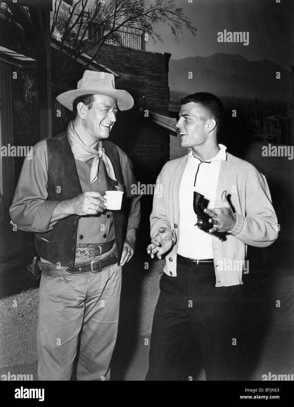 John Wayne, and his son, Pat Wayne, circa 1950s. CSU Archives/Courtesy Everett Collection - Stock Image