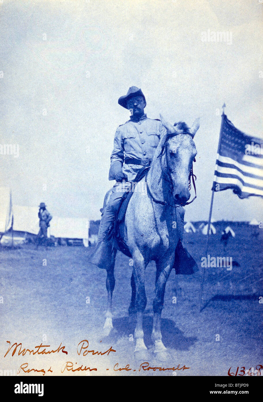 Colonel Theodore Roosevelt on horseback. Roosevelt organized the 1st Volunteer Cavalry, known as the Rough Riders - Stock Image