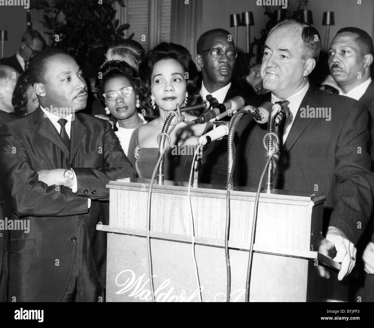 Dr. Martin Luther King Jr., with wife, Coretta Scott King,  Vice-President-elect Hubert Humphrey, speaking at reception Stock Photo
