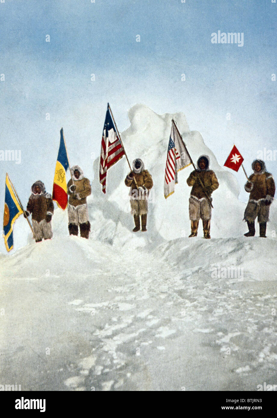 Robert Peary's Expedition holds five flags at the North Pole. (L to R): Navy League flag, DKE Fraternity flag, - Stock Image
