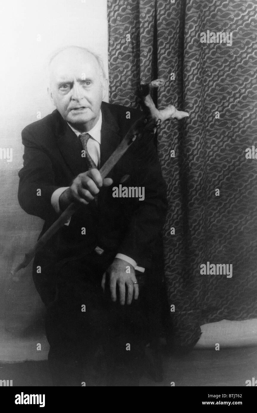 Padraic Colum (1881-1972) holding walking stick, in 1959 portrait by Carl Van Vechten, wrote poetry, novels, folklore, - Stock Image