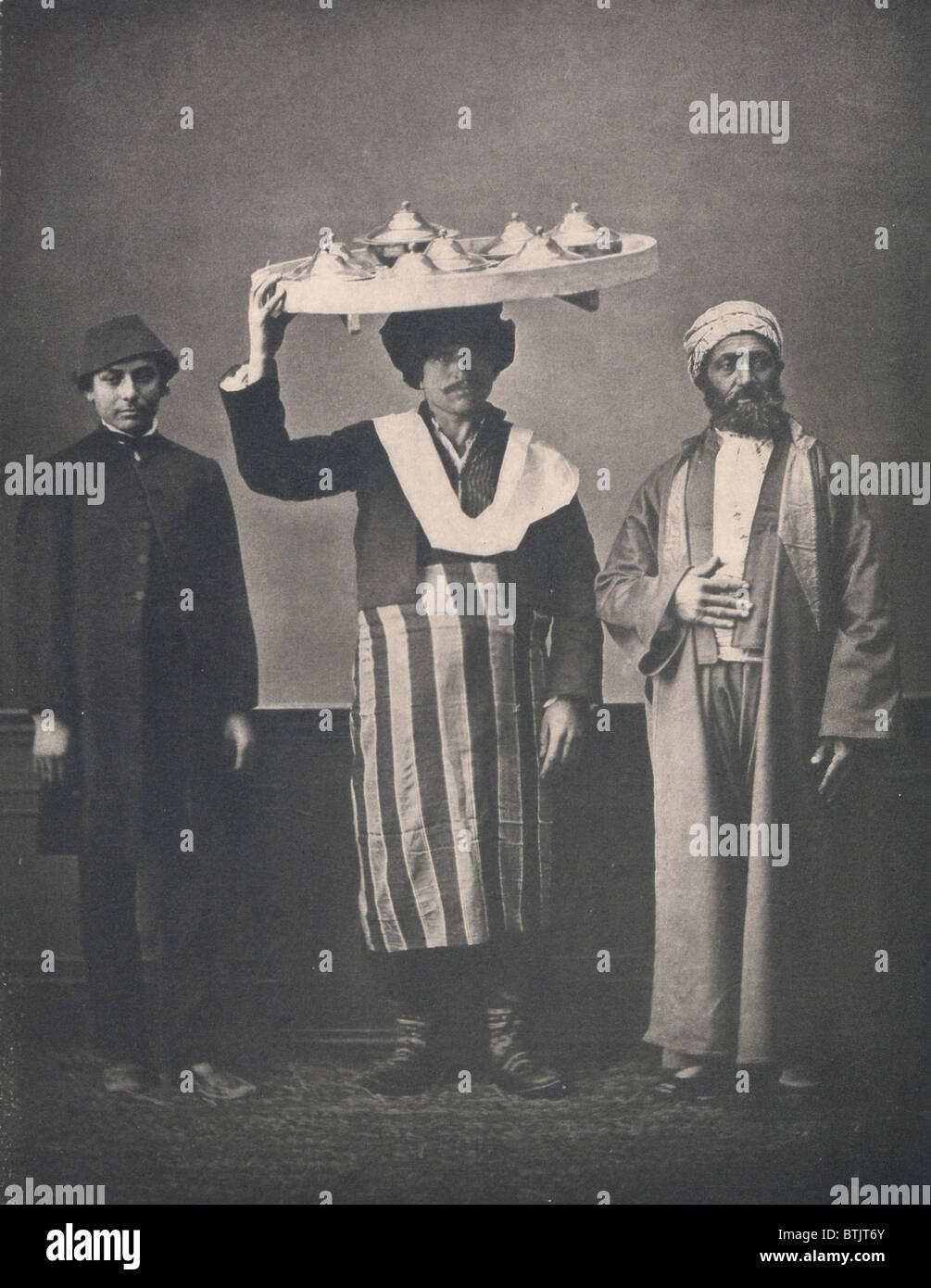 The Ottoman Empire, studio portrait of models wearing clothing from Istanbul, Bourgeois Muslim man of Constantinople - Stock Image