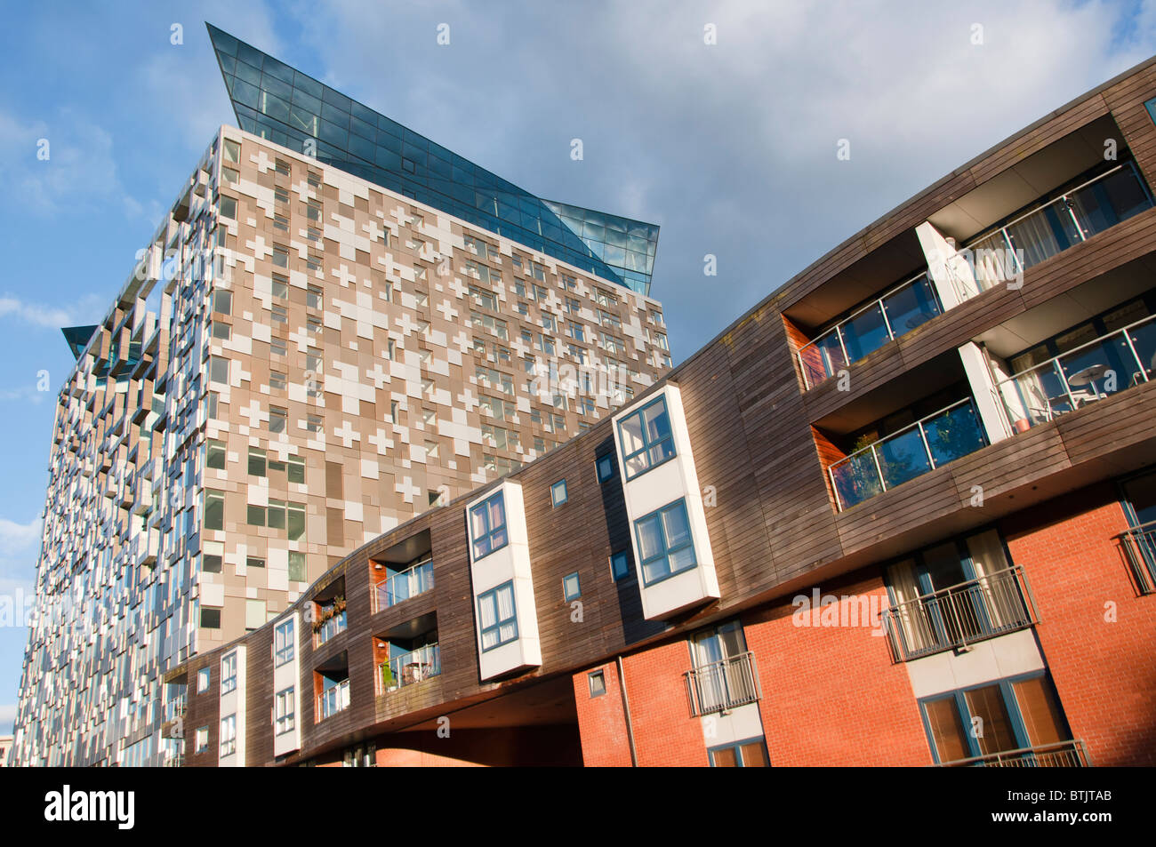 Apartments on the canal next to new 'Cube' building in Birmingham, UK - Stock Image