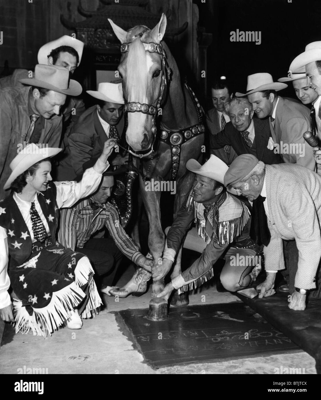 Western film star Roy Rogers (second from right), being honored at Grauman's Chinese Theater along with his - Stock Image