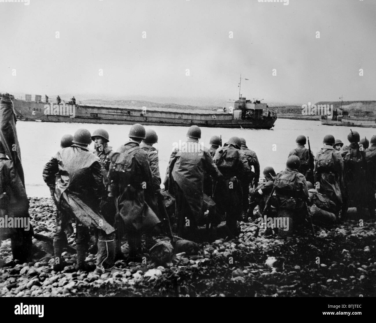 World War II, U.S. soldiers along the shore, circa 1940-1946. Stock Photo
