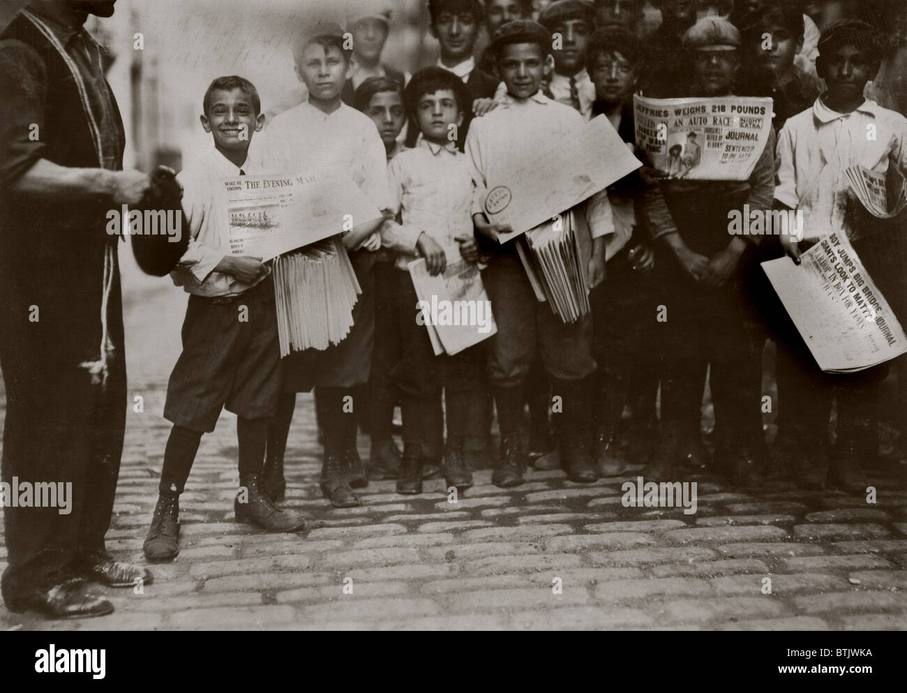 9fb2a3ff Newsboys with newspapers announcing the results of the boxing match between  James J. Jeffries,