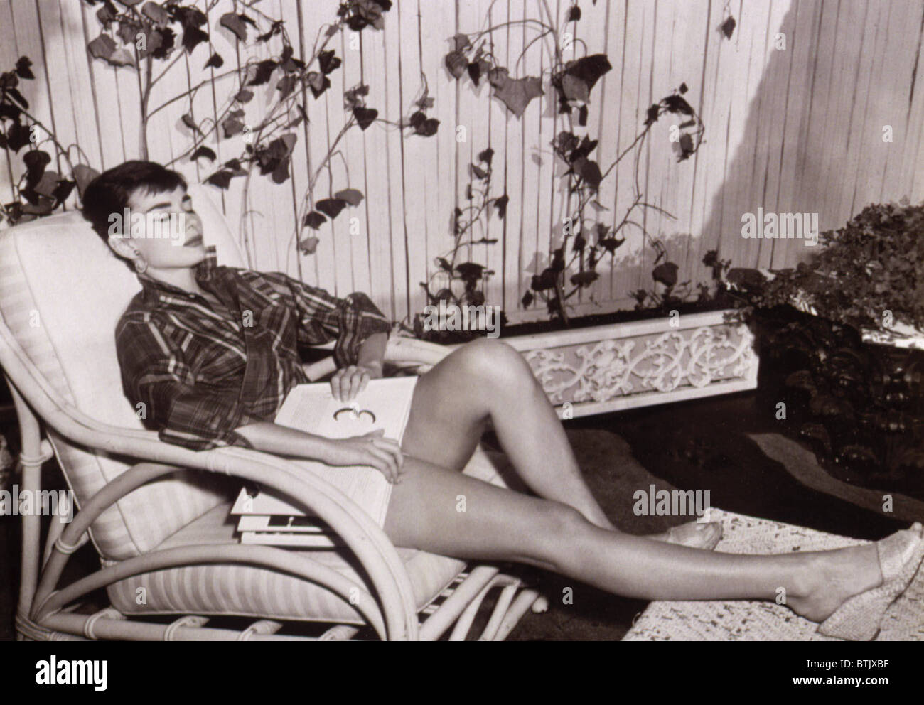 Audrey Hepburn resting with a script in her lap, 1954 - Stock Image