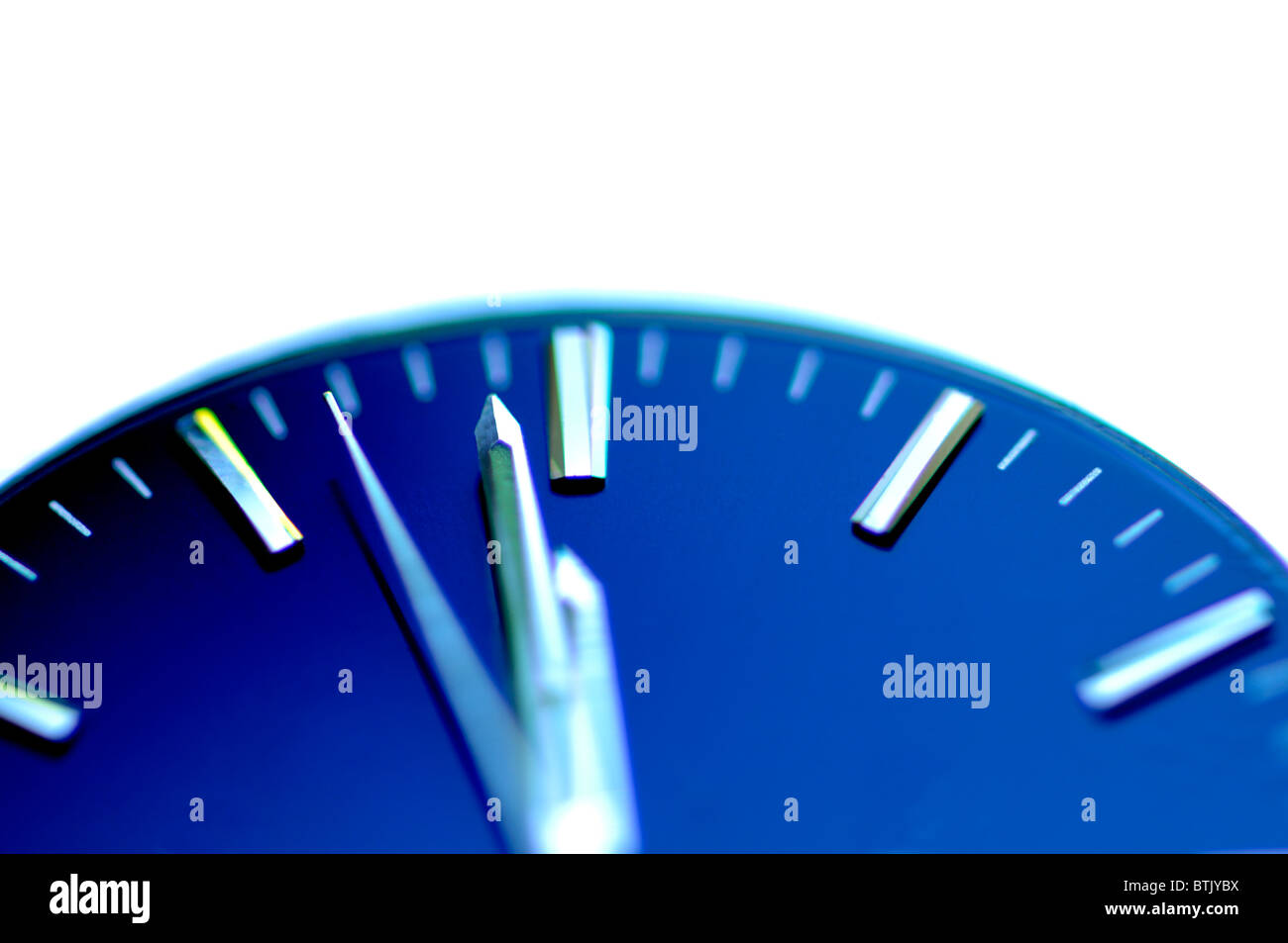 Watch face at one minute to midnight - Stock Image