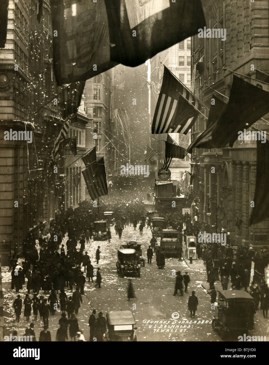 Old Glory. Flags wave over Wall Street, New York City in celebration of the surrender of Germany and the end of - Stock Image