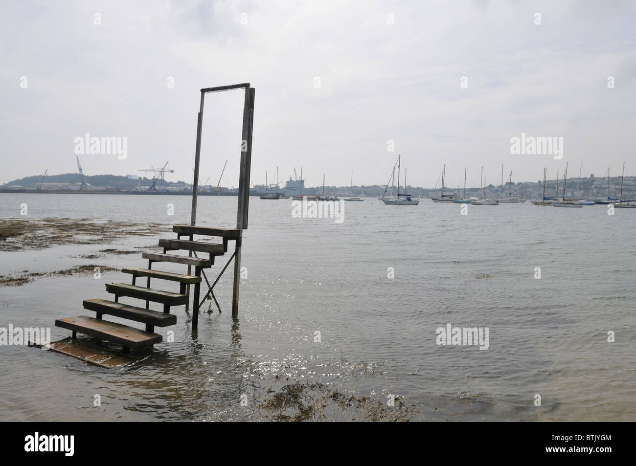 steps and a door frame leading to nowhere but the sea - Stock Image