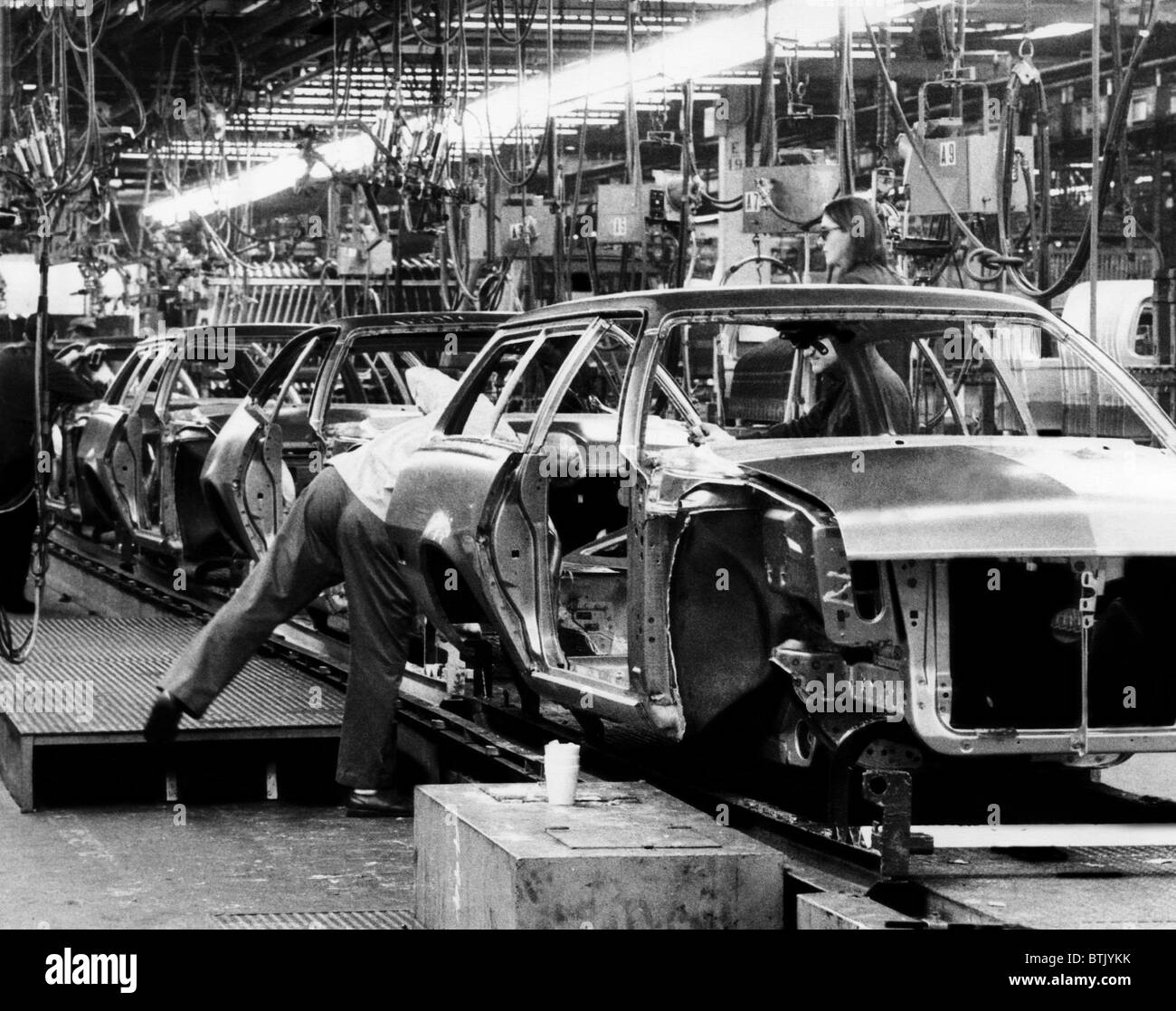 Cars move along the assembly line at the Ford plant in ...