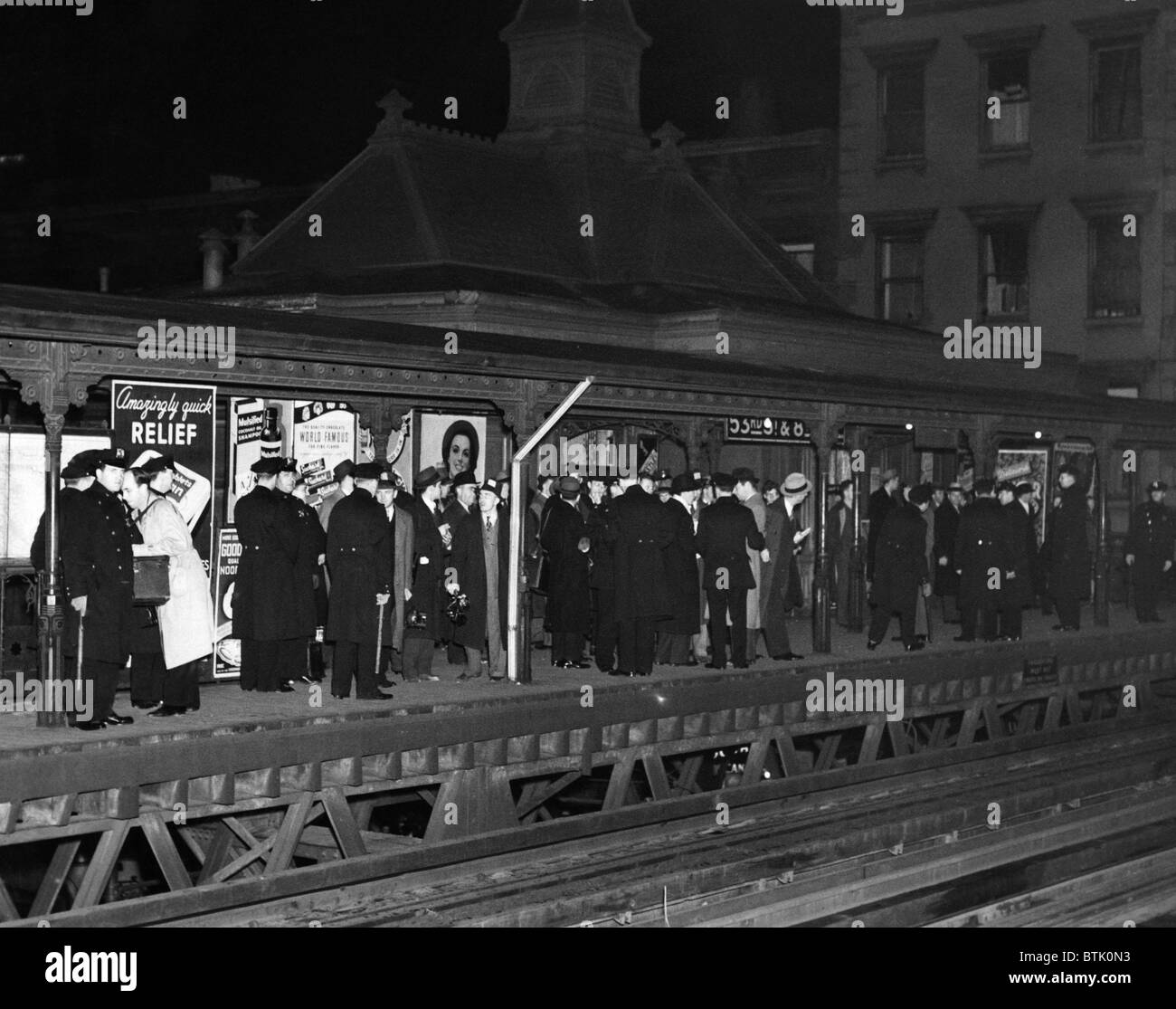 New York City police await the arrival of the last train on the soon to be demolished Sixth Avenue el. December - Stock Image