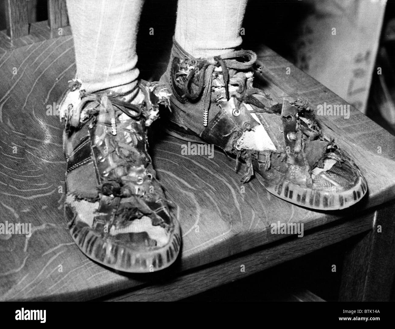 Sneakers, (School publicity shot supporting PTA's replacement of worn shoes), circa 1940-1950's - Stock Image